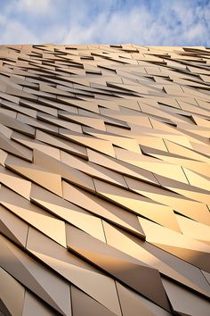 Each aluminium panel of the facade of Titanic Belfast is shaped specially to help create a unique design and dazzling effect. - Image - Design Build Network