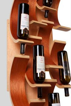 Curved Vino Shelving - The Falling Chips Wine Rack Interacts with the Wall Behind (GALLERY)