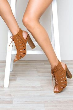 Rock and roll with the Presley Heel in chestnut! Features a faux suede material with cut-outs, a lace-up design and a peep toe opening. Synthetic wooden block heel. Side zipper closure for easy on and