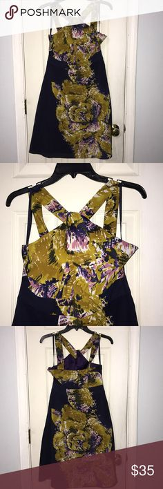 The Limited dress Beautiful dress for a night out or a cruise it's very light and comfortable. Colors are like a mustard, purple , pick and off white. Worn one time The Limited Dresses Midi