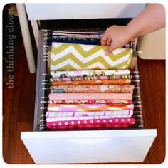 10 Ways to Store Fabric from Apartment Therapy 9. Literally file your fabric away and keep everything visible on hanging file folders, as displayed by Lauren of The Thinking Closet.