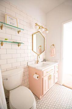 Tulsa Remodel Reveal Modern White Farmhouse modern glam pink girls bathroom gold hexagon mirror blush cabinet gold hardware white hexagon floors glass floating shelves-1 #ContemporaryInteriorDesign