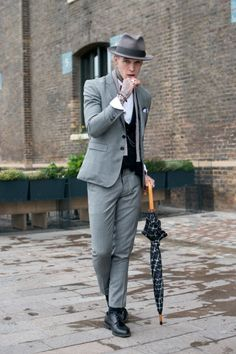 News Photo: Model Jimmy Q wears a Joshua Kane Bespoke…