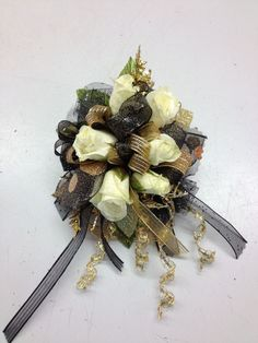 White mini spray rose corsage for prom with gold and black accents