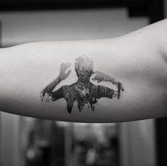 Nature-filled silhouette tattoo by Balazs Bercsenyi