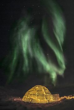 Image: Northern lights above an igloo outside Churchill, Manitoba, Canada. The Big Dipper can be seen in the sky above the igloo and the lig...
