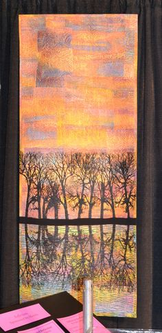 """""""Cottonwood Reflection"""" and is made by Cynthia St. Charles of Billings, Montana, USA. She hand-painted, collaged, block printed, Thermofax screen-printed and machine quilted this piece of art."""