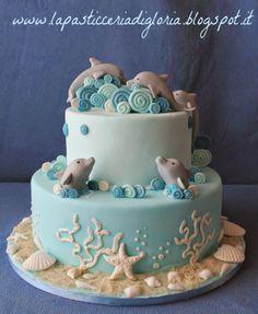 Una tenera torta con delfini
