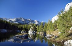 If you want to see a national park, your only option is the Triglav National Park. Description from backpackingworldwide.com. I searched for this on bing.com/images