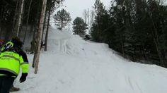 Snowmobile Hill Climber Meets Tree