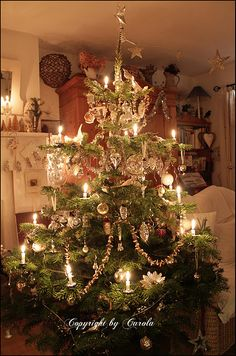 Vintage Christmas 2011...real fir tree & wax candles, vintage silver glass ornaments & tinsel garlands.