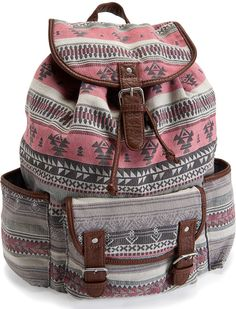 "Southwest Tribal Backpack - Our Southwest Tribal Backpack is a terrific pick for trendsetters on the go! The exterior is designed with a lively Southwest print and soft faux leather trim. Its roomy cinch-top interior, front pocket and two side pouches offer enough storage space for travel gear or school supplies. H 18"" x W 17"" x D 8"" Two adjustable shoulder straps. Cotton canvas with faux leather trim."