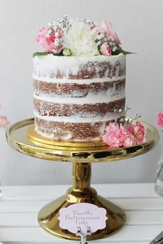 Vanilla buttercream cake at a vintage floral and lace baby shower party! See more party planning ideas at CatchMyParty.com!