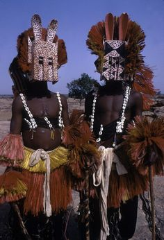 Africa | Dyomo masqueraders, from the Dogon people, during the Dama ceremony. Sanga, Mali. 1970. | ©Eliot Elisofon