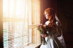 Beautiful red hair bride near window Beautiful red hair bride with flower bouquet standing near window waiting groom by dariazu