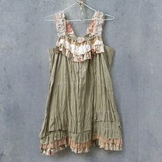 This girl makes the cutest upcycled boho/vintage clothing and jewelry!  Can't tell if she sells them anywhere though.