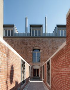 These homes designed by Studio Macola sit within the shell of an old factory in Venice