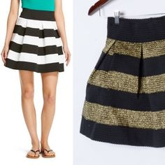 Gold and black elastic waist mini skirt This skirt is adorable. Thick elastic waist band and puffy silhouette make this skirt very comfy and also cute. Heavy, sturdy material. Good for winter. Excellent used condition Xhilaration Skirts Mini