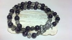 Used Tibetan Silver beads with deep Purple Fiber Optic beads (aka Mexican Opal and/or Tigers eye) and a silver tone magnetic buckle clasp