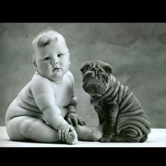 Baby with a Shar-pei