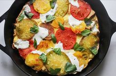 This heirloom tomato Caprese strata has us wondering why we haven't been eating this every day since forever.