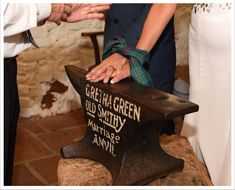 hand fastening over the anvil at Gretna Green