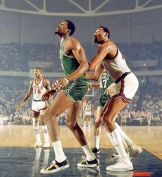 Two giants of the NBA, Bill Russell of the Boston Celtics boxes out Wilt Chamberlain of the 76ers during a game in Philadelphia.