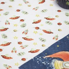 Space Adventure table confetti with rocket ship, robot, planet, UFO and star shapes.