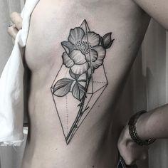 Blackwork floral piece on side