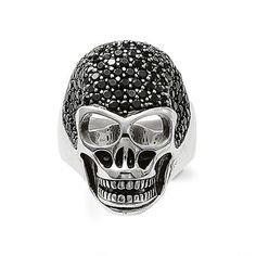 Unisex ring in the shape of a skull made from 925 Sterling silver. The top of the skull is adorned with black pavé-set zirconia, with blackened claws to create a harmonious overall look. (Width: 3.0 cm)