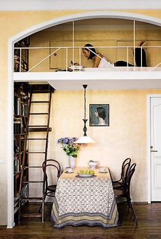 reading loft - love that the ladder leading up to it goes along a bookcase too :)