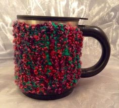 Multicoloured knitted wool mug warmer with a heart button close. Fits a regular sized mug. Hand wash only. Mug Warmer, Heart Button, Wool, Mugs, Tableware, Handmade, Etsy, Dinnerware, Cups