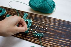 Make yourself a typography inspired DIY string art sign with just a few easy steps.
