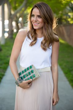 White top, skirt, embellished clutch
