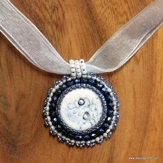 Hand-embroidered small round blue Pendant with ceramic button and pearls von JessicaMGrimm auf Etsy