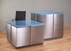 Cubic custom Reception Desks w/ Stainless Steel panels, Aluminum rails and Blue Frosted Glass