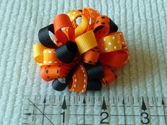 """My 4 year old, Abby, sporting a pair of Halloween-themed loopy bows NOTE: This tutorial creates one pair of 2.75"""" loopy bows. If larger bows are desired, cut individual ribbon lengths longer ( for example, 3"""" ribbon pieces for a..."""