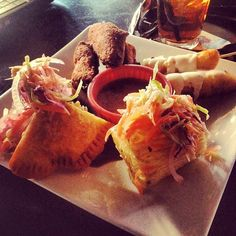 Roxy Platter wings, empanadas, fried yucca, plantain lollypops with sour cream, Salvadorian slaw. www.roxanneslounge.com