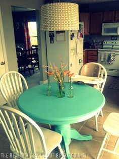 Def. have this table already thanks to Jenn but it's rectangle and the top is stained wood and bottom is turquoise distressed with 4 different type chairs and material and colors