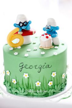 Smurfs theme cake by Bake-a-boo Cakes NZ, via Flickr