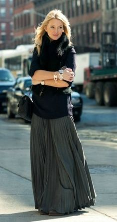 Chunky knit sweater and a beautiful maxi skirt and lots of bracelets/watch.