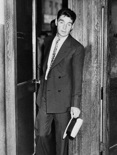 "Owney Madden, once public enemy No. 1 as a gang leader in New York's Hell's Kitchen (the ""Westies""), leaves the district attorney's office in New York City after testifying before a grand jury. Madden, having retired to Hot Springs, Arkansas, returned to face the probe, which was trying to determine the reason for his being on a coal company's payroll at $50 a week. Photographed: July 20, 1934"