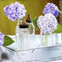 Ask moms around the office to bring in old glass baby bottles to use as vases for your centerpiece. A variety of different sizes and heights work well. If you're lucky enough to have blooms in your yard, clip some to make a casual flower arrangement or get a bunch from the florist and use a single stem in each bottle.