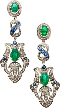 Emerald, Sapphire, Diamond, Silver-Topped Gold Earrings. The earrings feature oval-shaped emeralds weighing a total of approximately 5.00 carats, enhanced by round-shaped sapphires weighing a total of approximately 0.50 carat, accented by full-cut diamonds weighing a total of approximately 1.50 carats, set in silver-topped 14k gold, completed by posts and friction backs. Gross weight 16.20 grams. Dimensions: 2-3/4 inches x 1 inch
