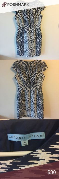 "Antonio Melani Cap Sleeve Dress Beautiful textured Antonio Melani dress. Cap sleeves, slight waist definition. Size 6. Fabric has no give. Fully lined. Length: 37"". Bust: 17"". Waist: 15"". Hips: 18.5"". Excellent used condition. A pretty dark blue with white design. ANTONIO MELANI Dresses Midi"