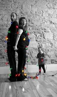 Cute Family Chirstmas Card Pic.. Yes this spin on the lights may be the way for my family of three to go (minus the pregnant belly :-)  )   It is so something my 10 year old would do!  Hmm gotta figure out how to do the blk & white with colored lights though....