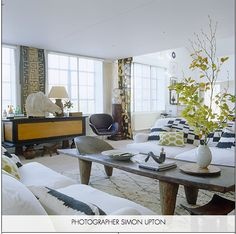 Love this room--layered rugs, small pattern on top of big natural.