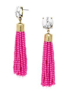 "These funky beaded tassels are the perfect shoulder-skimming accessory to make an apologetically bold statement. Features opaque neon gem embellishment. Earring is lightweight with a length of 3.6""."
