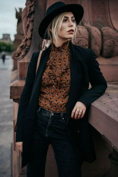Love this dressier blouse with black hat, cardigan and denim. Perfect makeup with amazing eyebrows.
