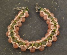Hey, I found this really awesome Etsy listing at https://www.etsy.com/listing/479391893/beaded-bracelet-unakite-czech-glass